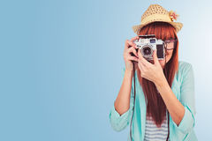 Composite image of portrait of a smiling hipster woman holding retro camera Royalty Free Stock Images