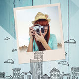 Composite image of portrait of a smiling hipster woman holding retro camera Stock Photos