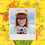 Composite image of portrait of a smiling hipster woman holding retro camera. Portrait of a smiling hipster woman holding retro camera against composite image of royalty free stock images