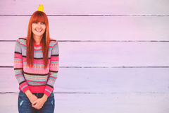 Composite image of portrait of a smiling hipster woman wearing hat party Royalty Free Stock Photography