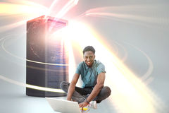 Composite image of portrait of smiling male university student using laptop 3d. Portrait of smiling male university student using laptop against red vortex with Royalty Free Stock Photos