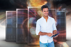 Composite image of portrait of smiling man using tablet computer 3d Stock Photo