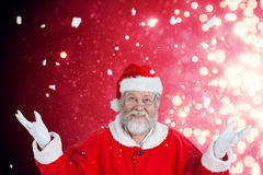 Composite image of portrait of smiling santa claus gesturing Royalty Free Stock Image