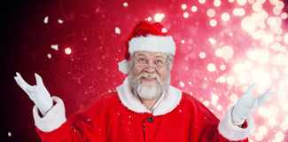 Composite image of portrait of smiling santa claus gesturing Royalty Free Stock Photos