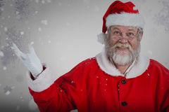 Composite image of portrait of smiling santa claus gesturing Royalty Free Stock Images