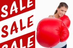 Composite image of portrait of a smiling woman boxing Stock Images