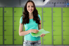 Composite image of portrait of smiling young woman with file Stock Photos