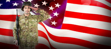 Composite image of portrait of soldier holding rifle and saluting Royalty Free Stock Image