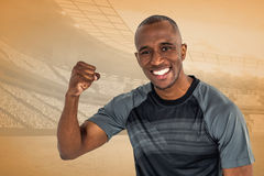 Composite image of portrait of sportsman cheering after success in rugby Stock Image