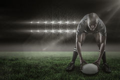 Composite image of portrait of sportsman holding ball while playing rugby 3d Royalty Free Stock Photography