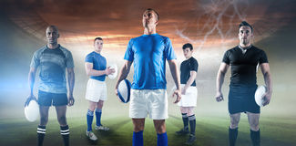 Composite image of portrait of sportsman holding rugby ball while standing Royalty Free Stock Photography