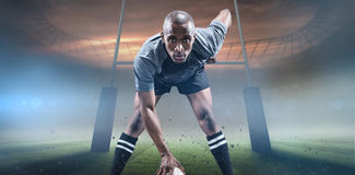 Composite image of portrait of sportsman playing rugby Stock Photo