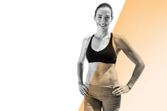 Composite image of portrait of sportswoman is posing and smiling Royalty Free Stock Images
