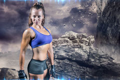 Composite image of portrait of sporty woman with gloves Stock Images