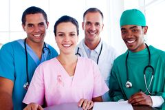 Composite image of portrait of a successful medical team at work. Portrait of a successful medical team at work against close-up of prostate cancer awareness royalty free stock photography