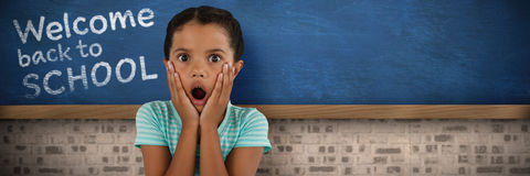 Composite image of portrait of surprised girl with head in hands royalty free stock photos