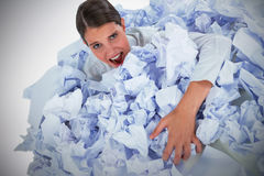 Composite image of portrait of unhappy businesswoman in heap crumpled paper stock photo