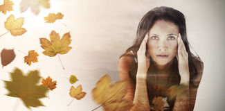 Composite image of portrait of upset woman with headache Stock Image