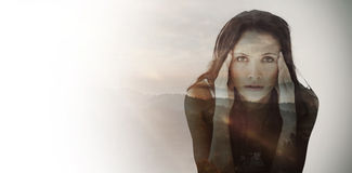 Composite image of portrait of upset woman with headache Royalty Free Stock Photos
