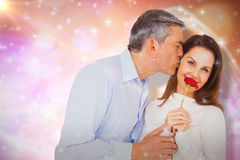Composite image of portrait of wife holding rose with husband Royalty Free Stock Photos