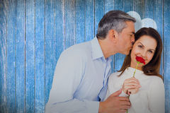 Composite image of portrait of wife holding rose with husband Stock Photos