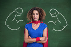 Composite image of portrait of a woman pretending to be superhero Royalty Free Stock Photos