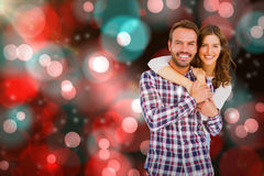Composite image of portrait of young couple smiling Stock Photography