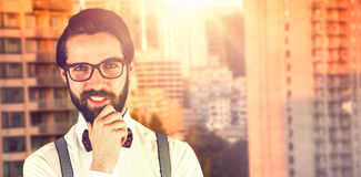 Composite image of portrait of young man smiling with hand on chin Royalty Free Stock Images