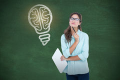Composite image of portrait of young woman holding clipboard and pen Royalty Free Stock Photography
