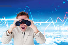 Composite image of positive businessman using binoculars Royalty Free Stock Image