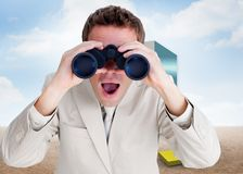 Composite image of positive businessman using binoculars Royalty Free Stock Images