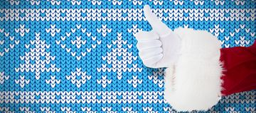 Composite image of positive santa claus with thumbs up. Positive santa claus with thumbs up against knitting christmas vector background cone tree royalty free stock image