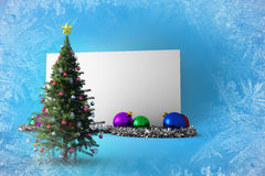 Composite image of poster with christmas tree. Against blue snowflake design Stock Images