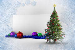 Composite image of poster with christmas tree. Against blue and white snowflake design Stock Photos