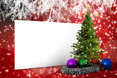 Composite image of poster with christmas tree. Against white snow and stars on red Royalty Free Stock Image