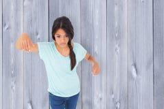 Composite image of powerless brunette. Powerless brunette against wooden planks Royalty Free Stock Photo