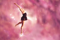 Composite image of pretty ballerina dancing Stock Images