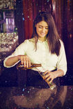 Composite image of pretty bartender preparing drink Stock Images