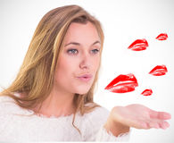Composite image of pretty blonde blowing a kiss Stock Photo