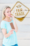 Composite image of pretty blonde feeling guilty to eat bar of chocolate Stock Images