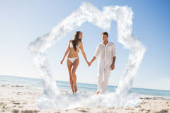 Composite image of pretty blonde holding hands with handsome boyfriend Royalty Free Stock Images