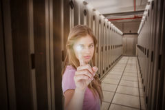 Composite image of pretty blonde pointing something with her finger Stock Photo