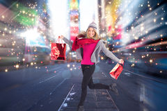 Composite image of pretty blonde posing in winter clothes Royalty Free Stock Photo