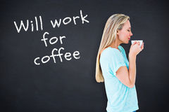 Composite image of pretty blonde standing and holding hot beverage Royalty Free Stock Photos