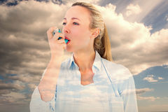 Composite image of pretty blonde using an asthma inhaler Stock Photos