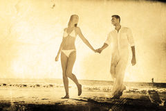 Composite image of pretty blonde walking away from man holding her hand Royalty Free Stock Images