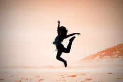 Composite image of pretty break dancer Stock Photos