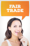 Composite image of pretty brunette eating bar of chocolate Royalty Free Stock Photos