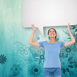 Composite image of pretty brunette gesturing with speech bubble Stock Photo