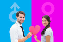 Composite image of pretty brunette giving boyfriend her heart Royalty Free Stock Photography